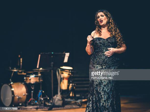 opera singer performing on the stage - opera singer stock pictures, royalty-free photos & images