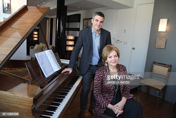 Opera singer Renee Fleming poses with composer Kevin Puts as she she practices for an upcoming premiere at her apartment in New York City on November...