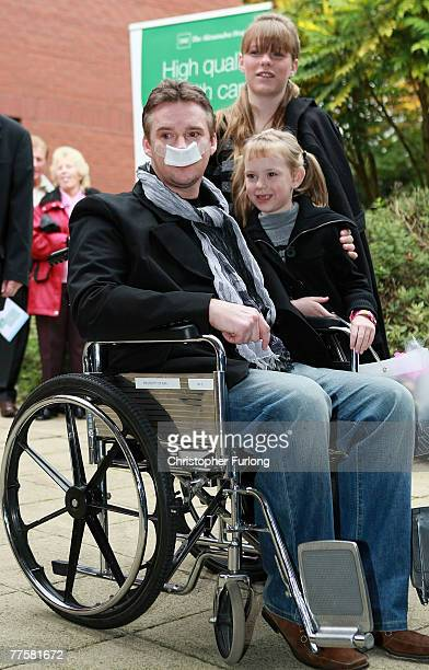 Opera Singer Russell Watson leaves Alexandra Hospital with his daughters Rebecca and Hannah 8 to recover at home after brain surgery on October 31...