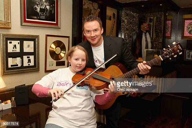 Opera Singer Russell Watson poses with cancer sufferer 18 year old Lizzy Davies for a photograph at a photocall to launch PracticeAThon at the Hard...
