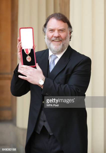 Opera singer Sir Bryn Terfel after he was knighted for services to music by Queen Elizabeth II during an Investiture ceremony at Buckingham Palace on...