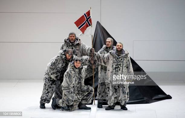 Opera singer Thomas Hampson as Roald Amundsen and a member of Amundsen's team of explorers perform on stage during a rehearsal of the opera 'South...
