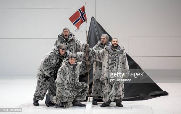 Opera singer Thomas Hampson as Roald Amundsen and a member of the ensemble perform on stage during a rehearsal of the opera 'South Pole' at the...