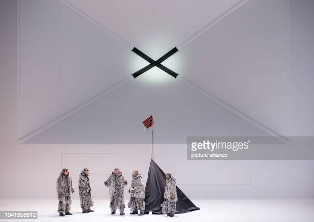 Opera singer Thomas Hampson as Roald Amundsen and members of Amundsen's team of explorers perform on stage during a rehearsal of the opera 'South...