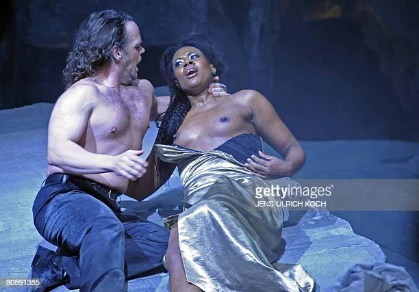 Opera singers Adina Aaron as Amelia and Erik Fenton as Riccardo perform on stage during a rehearsal of Giuseppe Verdi's opera Ein Maskenball directed...