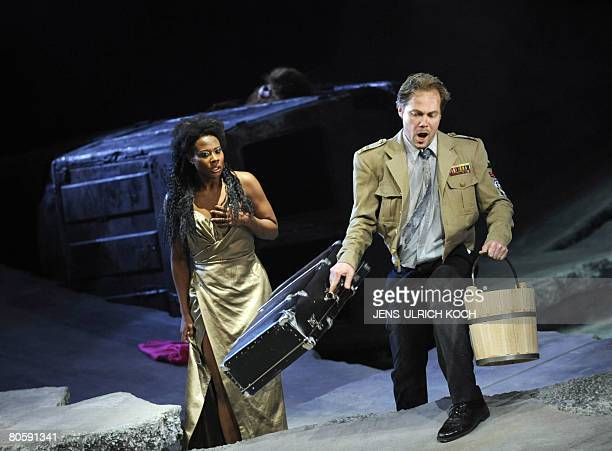 Opera singers Adina Aaron as Amelia and Petteri Falck as Renato perform on stage during a rehearsal of Giuseppe Verdi's opera Ein Maskenball directed...