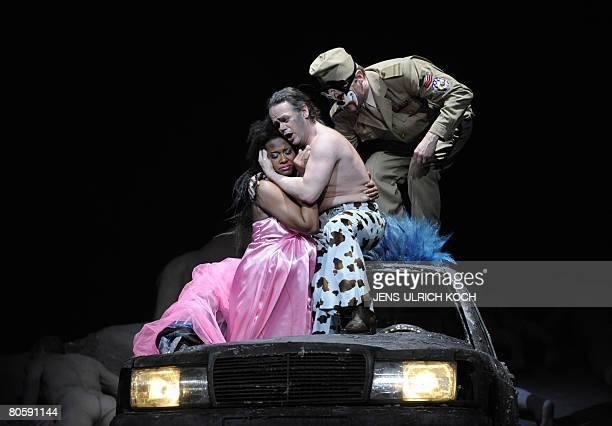 Opera singers Adina Aaron as Amelia Erik Fenton as Riccardo and Petteri Falck as Renato perform during a rehearsal of Giuseppe Verdi's opera Ein...