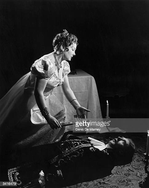 Opera singers, Amy Shuard and Frederick Sharp as Tosca and Scarpia during a production of Puccini's opera 'Tosca'.