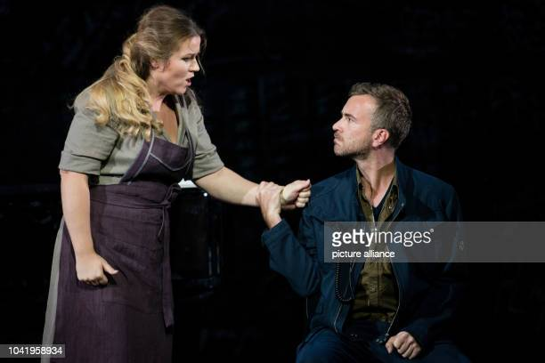 Opera singers Evelin Novak as Marzelline and Florian Hoffmann as Jaquino stand on stage during a photo rehearsal of the opera 'Fidelio' of the State...