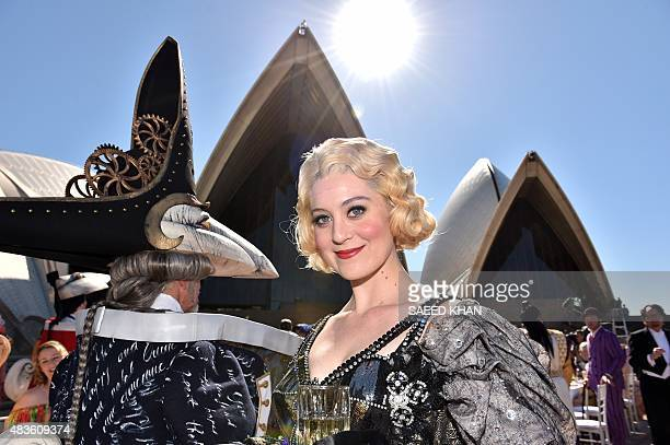 Opera singers in costume celebrate the 60th anniversary of Australias national opera company during a ceremony marking the start of Opera Australia's...
