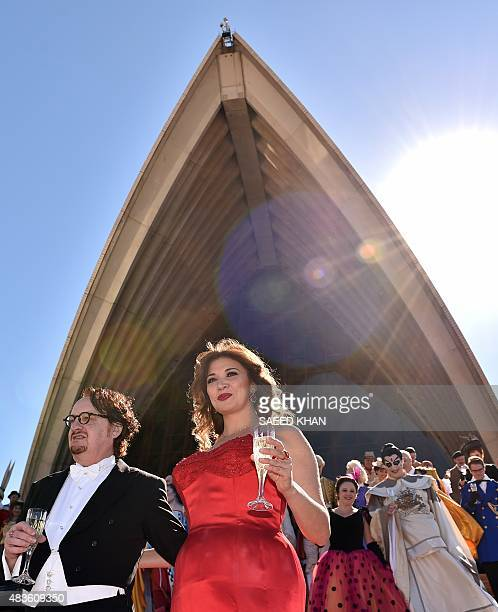 Opera singers in costume walk down the stairs as they celebrate the 60th anniversary of Australias national opera company during a ceremony marking...