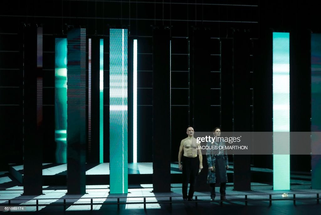 Opera singers Laurent Naouri and Christian Helmer (R) performs during the rehearsal of 'Trompe la mort' at the Paris opera on March 10, 2017. / AFP PHOTO / Jacques DEMARTHON