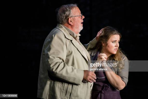 Opera singers Matti Salminen as Rocco and Evelin Novak as Marzelline stand on stage during a photo rehearsal of the opera 'Fidelio' of the State...