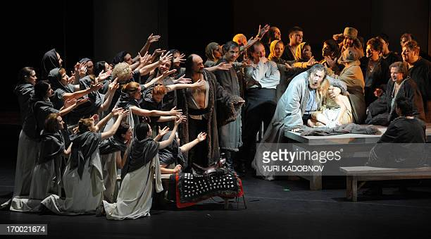 Opera singers perform during the dress rehearsal of the Prince Igor opera by Russian composer Alexander Borodin at the Bolshoi theatre in Moscow on...
