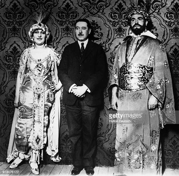 Opera singers Vidal Izal and Senorita Revenja from a production flank the Spanish operatic composer Joaquin Turina March 1923