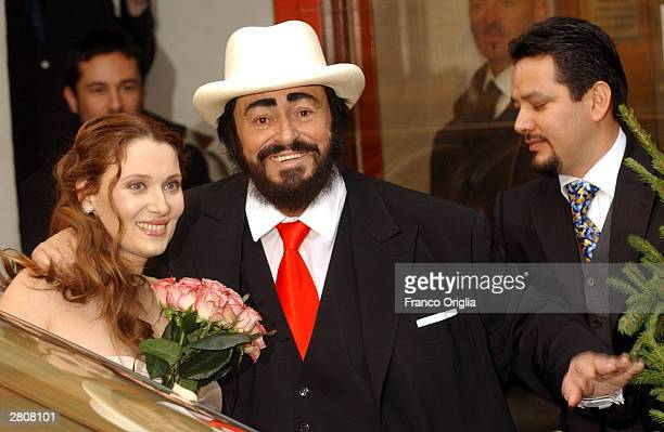 Opera star Luciano Pavarotti and Nicoletta Mantovani smile as they leave the Teatro Comunale at the end of their wedding December 13 2003 in Modena...