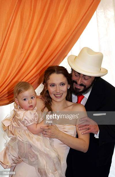 Opera star Luciano Pavarotti his wife Nicoletta Mantovani and their daughter Alice Pavarotti pose during the party of their wedding December 13, 2003...