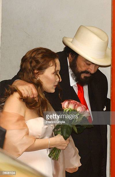 Opera star Luciano Pavarotti Nicoletta Mantovani leave the Teatro Comunale at the end of their wedding December 13 2003 in Modena Italy
