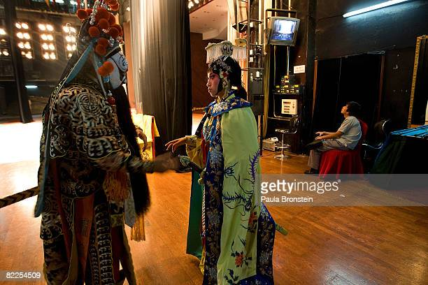 Opera stars chat backstage before a performance at the Peking Opera at the Regal Palace theater August 11 2008 in Beijing China Special performances...
