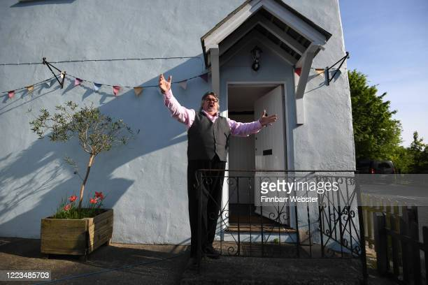 Opera tenor singer John Hudson who should be currently touring Sweden performs to cheer up his village of Piddlehinton in Dorset every Thursday...