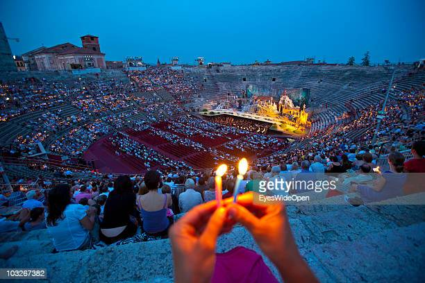 Operagoers are holding candle lights up at the beginning of the opera Madame Butterfly in the Arena of Verona on July 14 2010 in Verona Italy The...