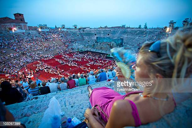 Operagoers are sitting on the stone steps in the Arena of Verona on July 14 2010 in Verona Italy The famous Arena di Verona is popular for the annual...