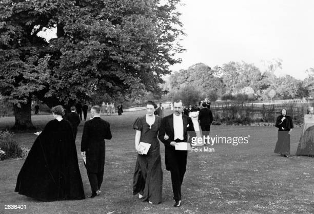 Operagoers walk in the gardens during an interval at Glyndebourne Opera House Sussex Original Publication Picture Post 164 Glyndebourne pub 1939