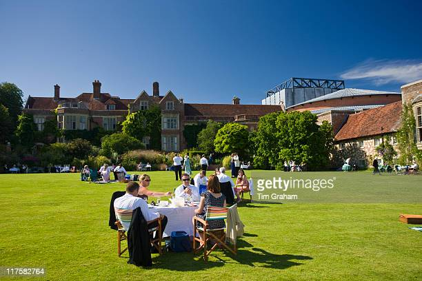 Operalovers attend annual Glyndebourne Opera Festival and picnic in the grounds Glyndebourne East Sussex UK