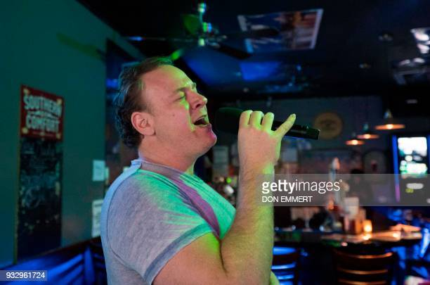 Operatic baritone Lucas Meachem who is performing in 'La Boheme' at the Met sings at a karaoke bar on March 8 2018 in New York His voice packing an...