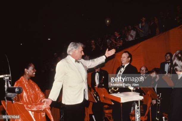 Operatic mezzosoprano Shirley Verrett and composer and conductor Leonard Bernstein acknowledge the band at the Gay Men's Health Crisis AIDS benefit...