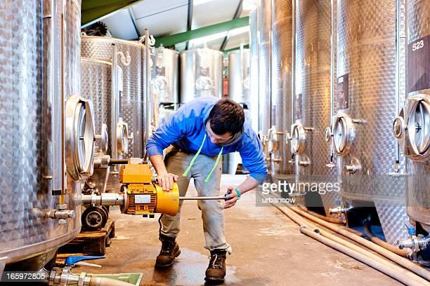 operating fermentation tanks - vorratstank stock-fotos und bilder