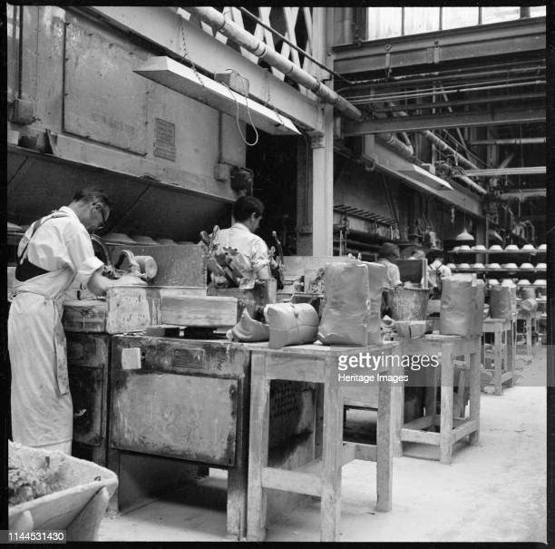 Operating jiggers in a pottery works StokeonTrent 19651968 Men operating jiggers manufactured by William Boulton of Burslem A jigger is a machine for...