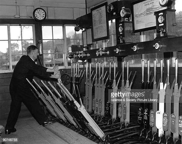 Operating the points levers at Horsted Keynes signal box, British Railways .