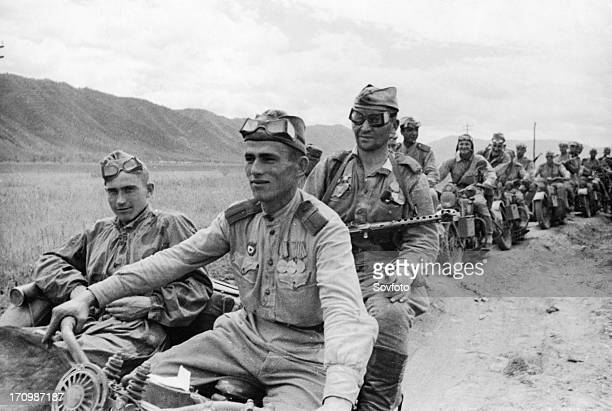 Operation august storm , a squad of motorized soviet automatic riflemen advancing across the manchurian steppes against the japanese, august 1945.