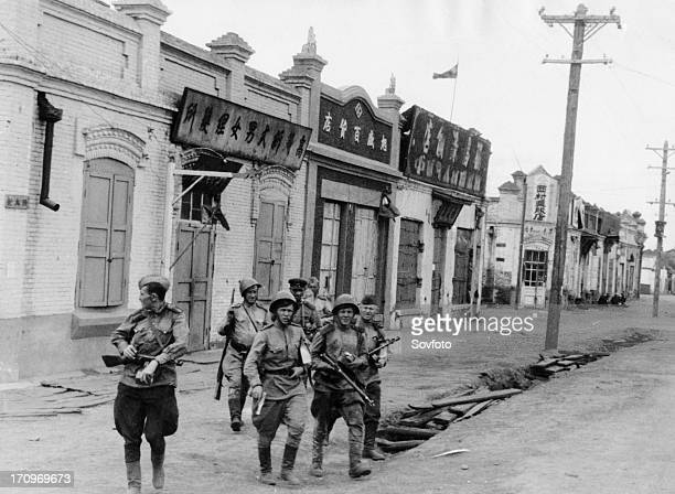 Operation august storm automatic riflemen of the red army units of the transbaikal front in the streets of captured hailar manchuria august 1945
