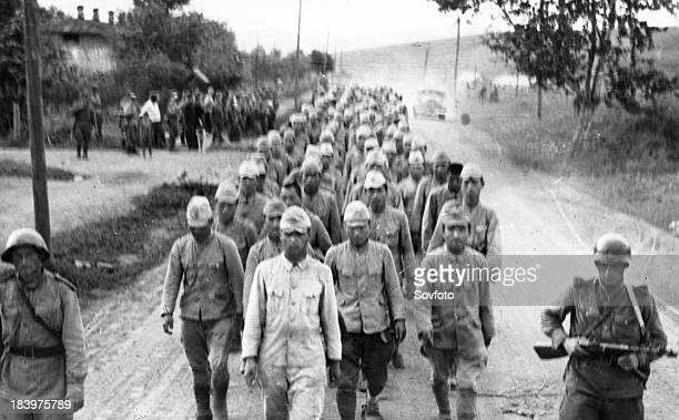 Operation August Storm . Japanese prisoners being led by Red Army troops in Li-shenchen. Manchuria. August 1945.