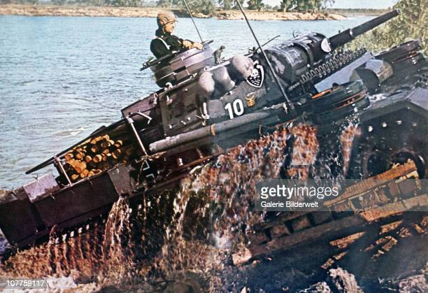 "Operation Barbarossa A tank of the SS division ""Das Reich"" has crossed a river on the Eastern Front in Russia 1941 The division operated on the..."