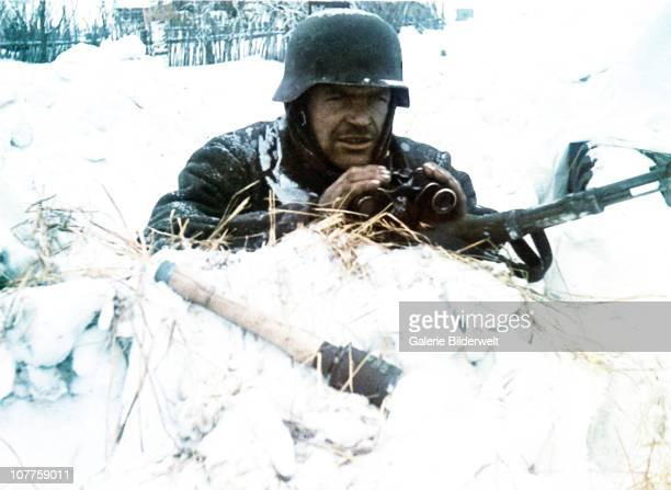 Operation Barbarossa A Wehrmacht soldier is guarding a village under the snow 1941 He has a hand grenade and gun ready for unexpected attacks He is...