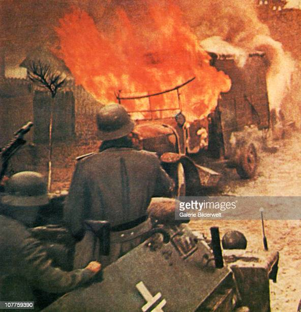 Operation Barbarossa German soldiers in armoured vehicle of the Wehrmacht are approaching a burning Russian truck 1943 They are part of over 45...