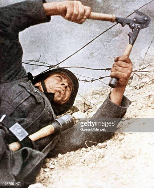 Operation Barbarossa This Wehrmacht soldiers is cutting the barbed wire the enemy has installed 1942 He is part of over 45 million troops of the Axis...