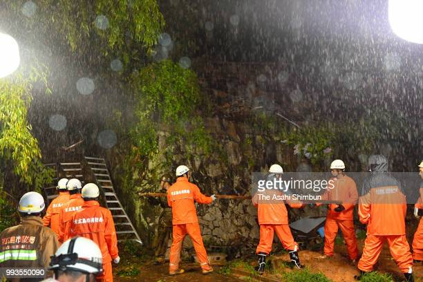 Operation continues to rescue 3 people buried by a landslide on July 7 2018 in Higashihiroshima Hiroshima Japan 51 people were killed and 58 missing...
