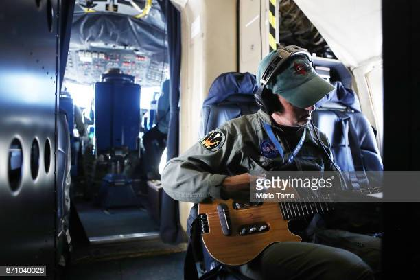 Operation IceBridge mission scientist John Sonntag plays his guitar following a long science flight aboard NASA's research aircraft in the Antarctic...
