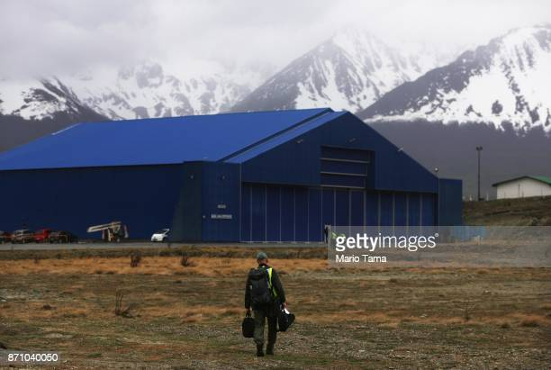 Operation IceBridge mission scientist John Sonntag walks to the hangar following a long science flight aboard NASA's research aircraft in the...