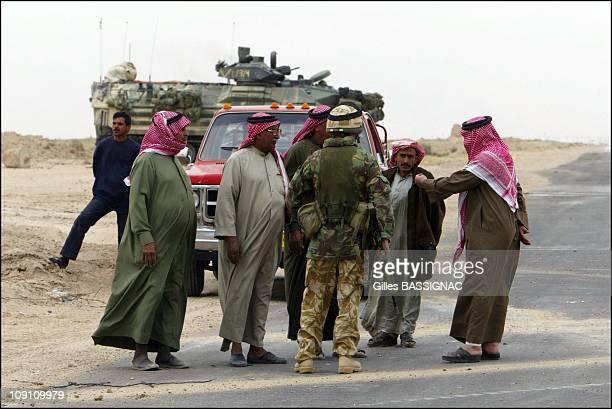 Operation Iraqi Freedom British And Us Troops Around Basrah On March 22 2003 In Bassorah Iraq Us Marine And Iraqi People