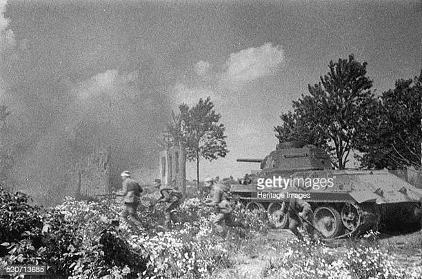 Operation Kutuzov. Soviet troops follow their tanks near Orel. Found in the collection of Russian State Film and Photo Archive, Krasnogorsk.