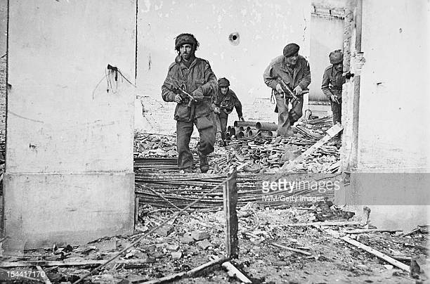 Operation 'Market Garden' 17 25 September 1944 Arnhem 17 25 September 1944 Four British paratroopers moving through a shelldamaged house in...