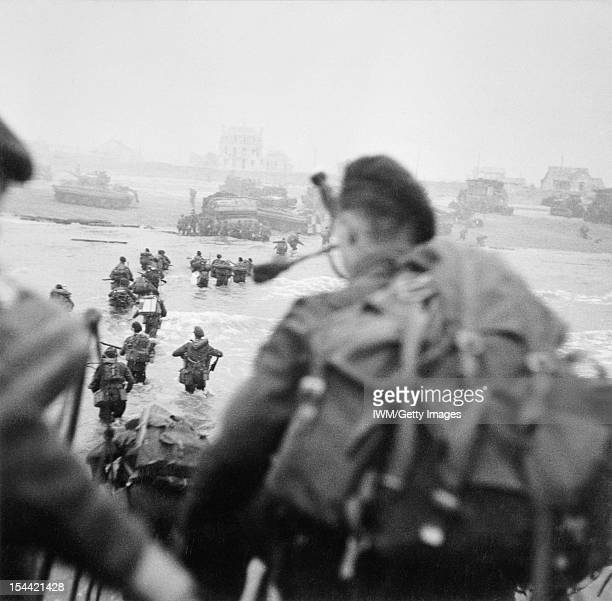 Operation Overlord DDay 6 June 1944 The British 2nd Army Commandos of 1st Special Service Brigade landing from an LCI on 'Queen Red' Beach SWORD Area...