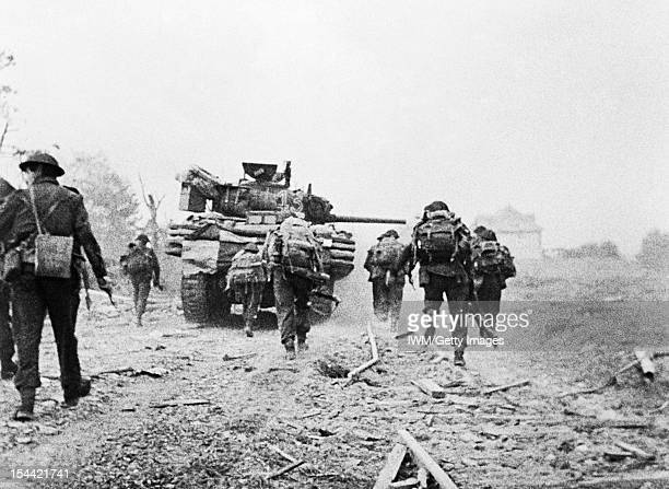 Operation Overlord DDay 6 June 1944 The British 2nd Army Sherman DD tanks of 'B' Squadron 13/18th Royal Hussars and men of No 4 Army Commando...