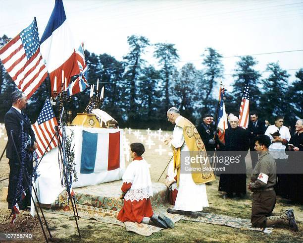Operation Overlord Normandy, A catholic priest is performing a religious service in the Normandy American Cemetary of Colleville sur Mer. July 1944....