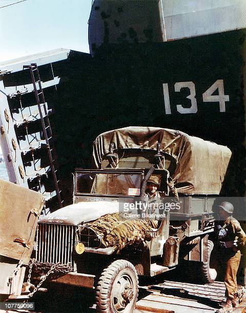 Operation Overlord Normandy, A truck GMC for task force 124.5 1st Infantry Division of the United States Army is loaded into the Landing Ship Tank...